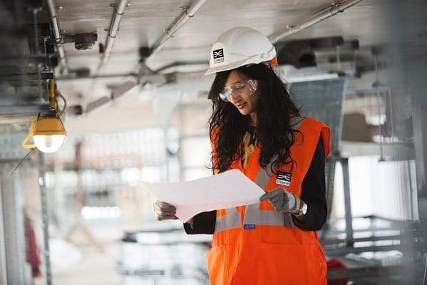 Arab woman engineer looking at plans