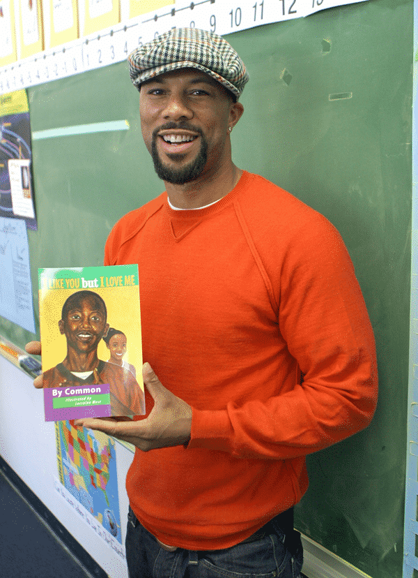 Common standing posing with his childrens book