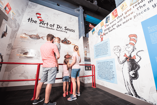 family of four look at WonderWorks museum exhibit