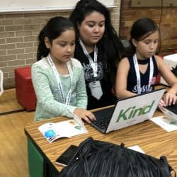 Mom with two daughters at computer learning online safety