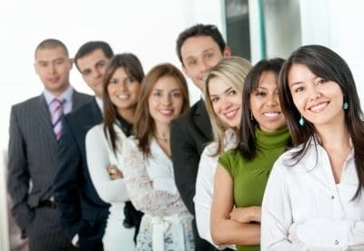 Group of career professionals lined up outside office building