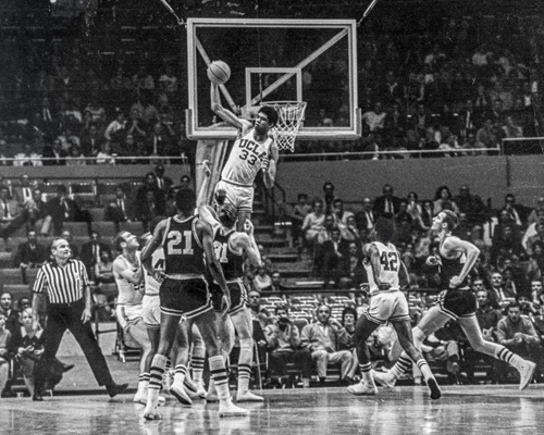 One of the iconic photos in UCLA basketball history taken by Norm Levin: Lew Alcindor, the 7-foot-2 big man who would one day wind up as NBA superstar Kareem Abdul-Jabbar, getting all of the ball for a blocked shot against the University of Minnesota on Dec. 27, 1967