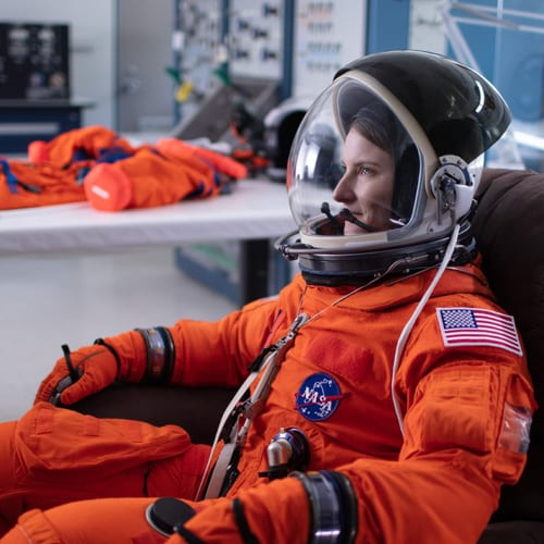 Astronaut Candidate Kayla in spacesuit