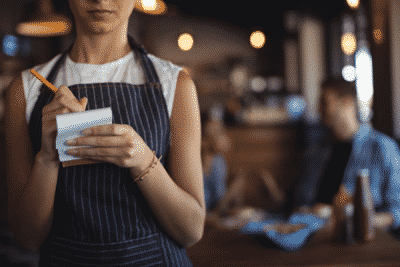waitress taking orders on a notepad