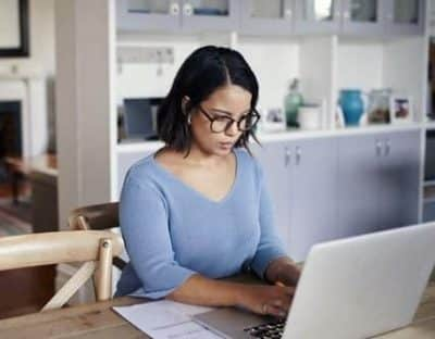 woman working remotely on computer at home