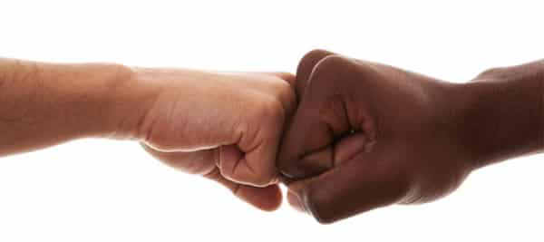 fist pump between a white and black hand