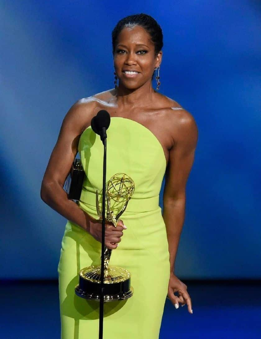 Regina King accepting Emmy while holding the emmy in hand