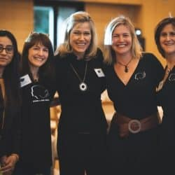 Stanford women in stem pose together with arms around each other shoulders smiling