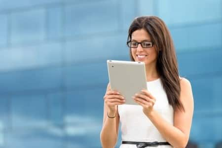 young woman on tablet outside