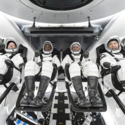 Four Space X astronauts seated in SpaceX's Crew Dragon