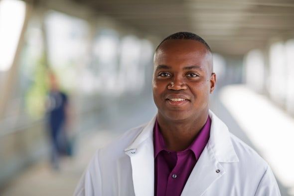 A Black scientist wearing a lab coat closeup