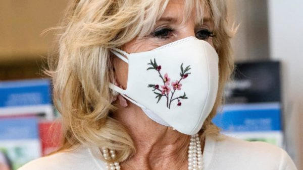 jill biden up close photo wearing a white mask with flowers