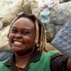 black female engineer holding a brick recycled from plastic