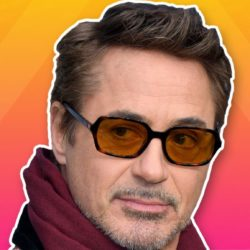 Robert Downey Jr close up, wearing glasses, with gradient orange and pink background