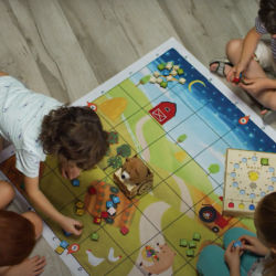 Student playing on the floor with the Mochi Adventure game