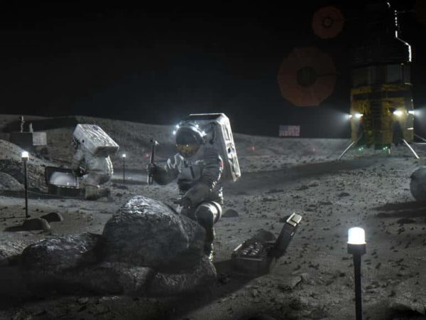 Astronauts on the moon gathering samples from the ground and rocks.