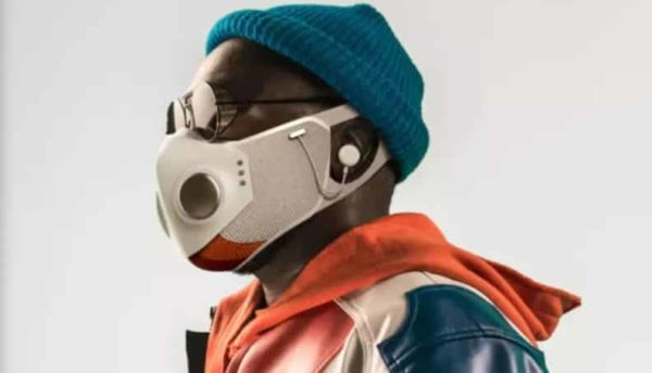 Will.i.am wearing the technology powered face mask with a blue beanie on