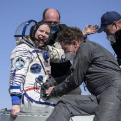 NASA astronaut Kate Rubins is helped out of the Soyuz MS-17 spacecraft