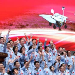 Scientists and engineers cheer the successful landing of Zhurong – a six-wheel rover – on Mars.