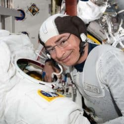 Astronaut Mark Vande Hei conducting a spacesuit fit check on before the cancelation of spacewalk