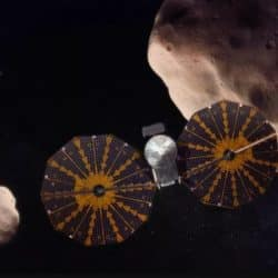 An artist's depiction of NASA's Lucy spacecraft studying asteroids. (Image credit: SwRI)