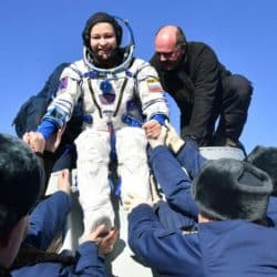 Russian space agency rescue team members help actress Yulia Peresild out from the capsule shortly after the landing of the Russian Soyuz MS-18 space capsule from iss