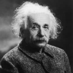 black and white photo of einstein looking at the camera